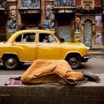 Person sleeping under a yellow blanket, India, 1996 final book_iconic