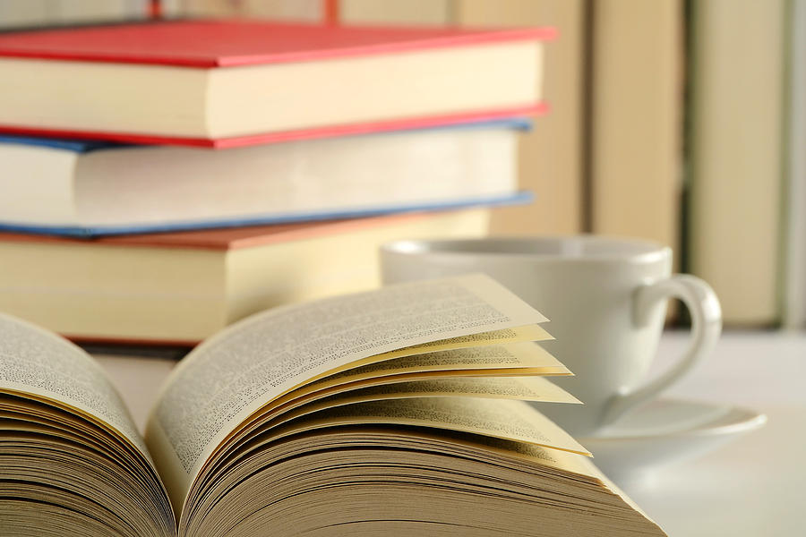 composition-with-books-and-cup-of-coffee-on-the-table-t-monticello