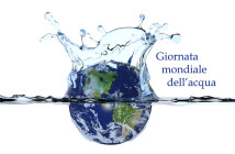 Planet Earth slpashing in water surface causing a water crown and ripples. Isolated over white. Globe shows North- and South America and is surrounded by clouds. Includes clipping path.